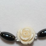Magnetic Hematite Necklace - White Rose Center Stone, Clear Beads